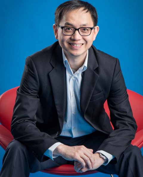 Singapore professional photography of a business leader seating in a red chair, image by Tuckys Photography
