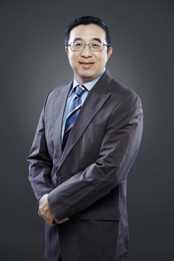 Corporate head shot for Head of Human resource Singapore Professional photographer from Tuckys Photography