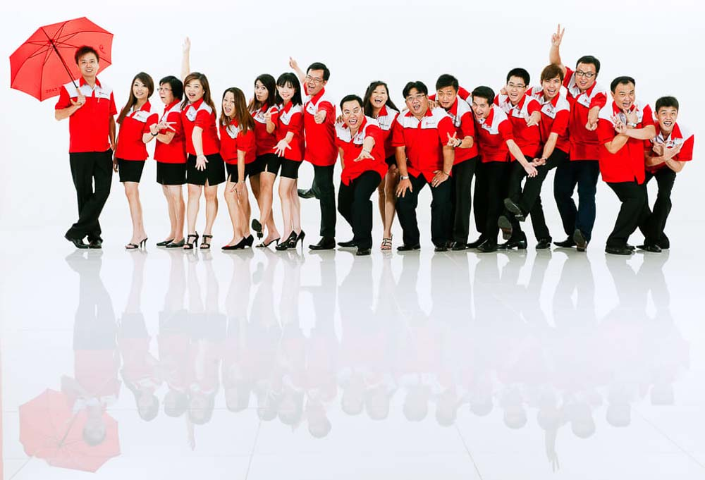 Professional corporate photography for sales team in red unifrom in studio, Tuckys Photography