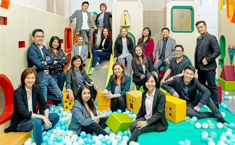 candid corporate group portraits photography in a indoor playground. Tuckys photography