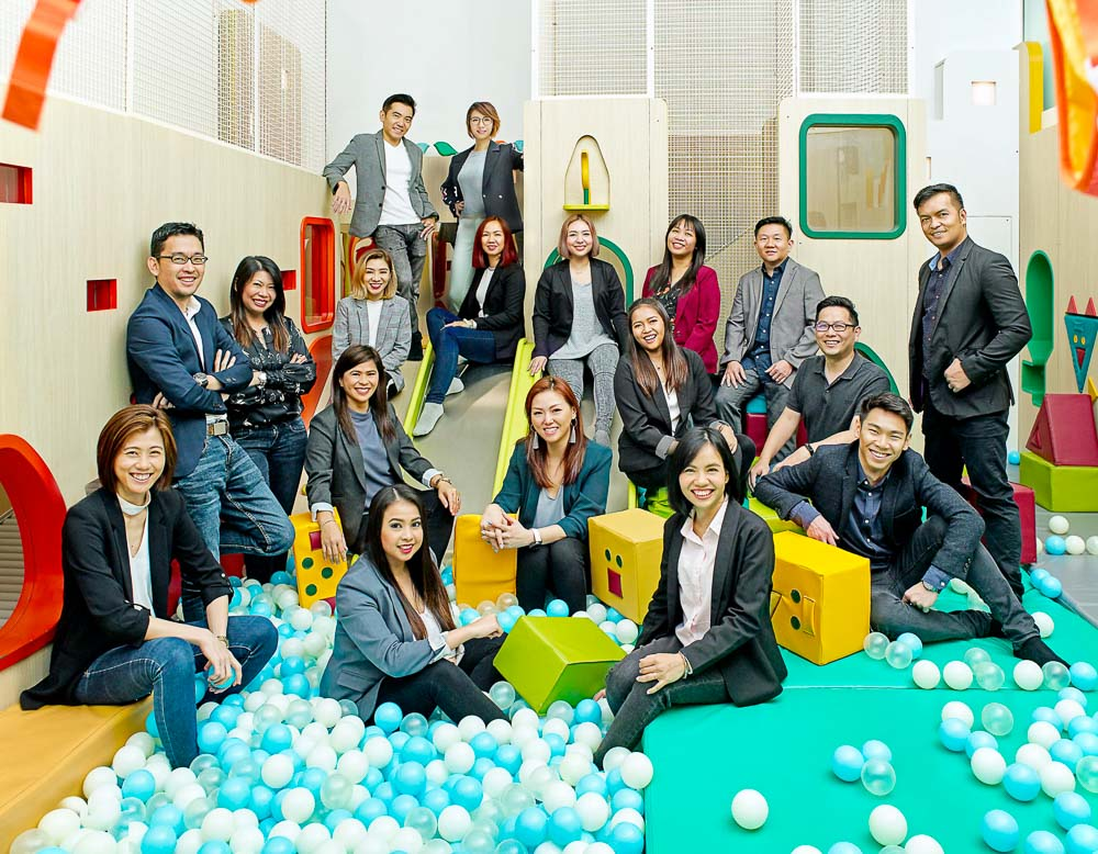 candid corporate group portraits photography in a indoor playground, Tuckys photography