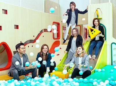 Group portraits photography for corporate with studio lighting at indoor playground, Tuckys photography