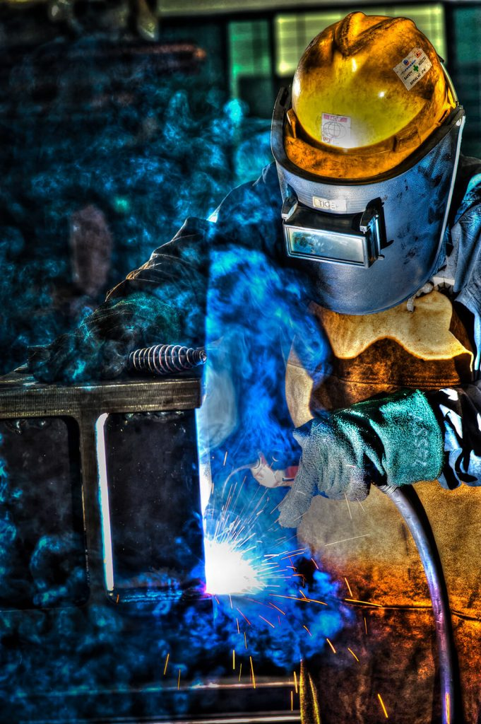 corporate lifestyle photography of man welding. tuckys photography