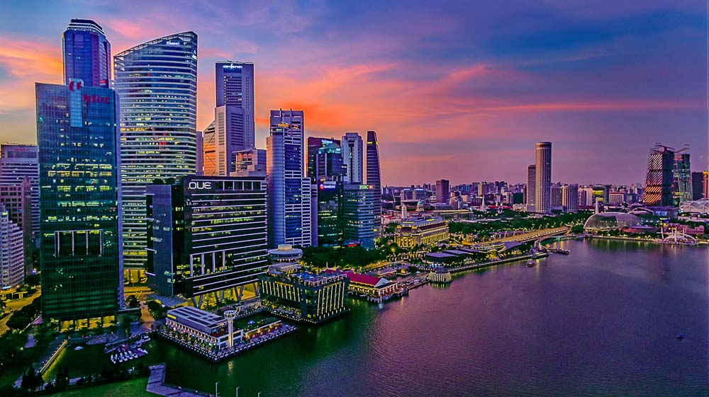 Aerial drone image of the city skyline at golden hour, by aerial photographer, tuckys